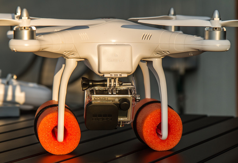 DJI Phantom UAV with GoPro HERO 3 Black Series camera and over-water floats.