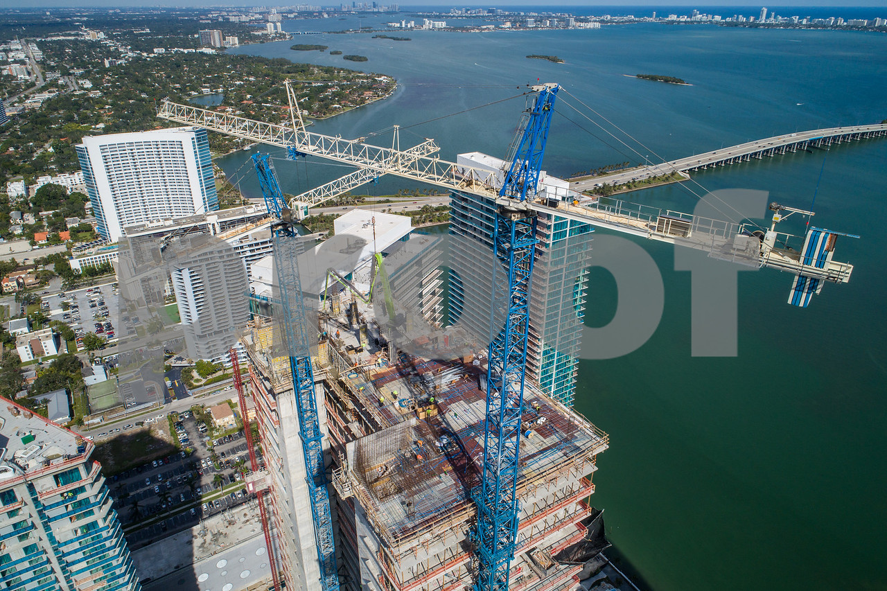 Highrise architecture under construction with cranes aerial image