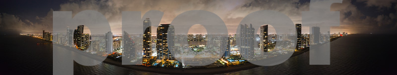 Aerial Sunny Isles Beach Miami Florida night panorama over water towards city