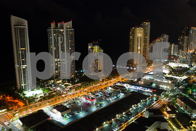 Night aerial photo Sunny Isles Beach Florida luxury highrise towers