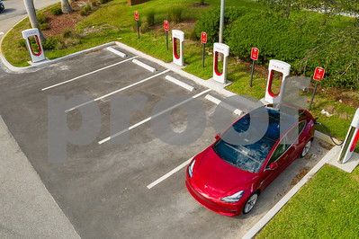 Aerial photo Tesla Model 3 supercharging