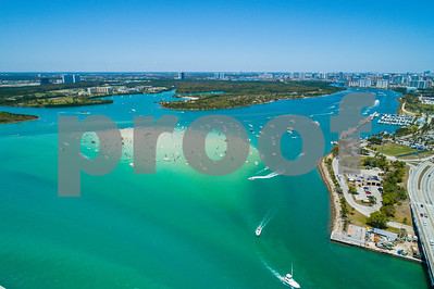 Aerial drone image of Haulover Beach Miami Florida sandbar with boats crowded on the weekend