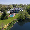 Aerial View of Luxury Home with Pond