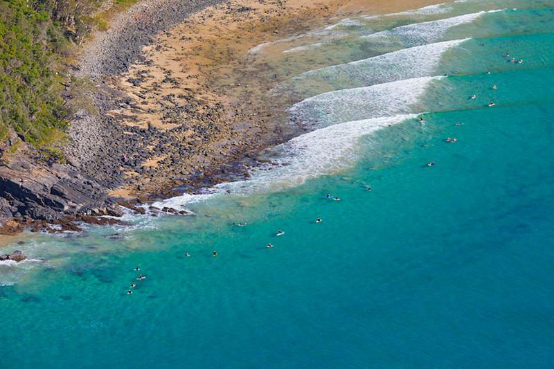 Surfing Noosa Headland