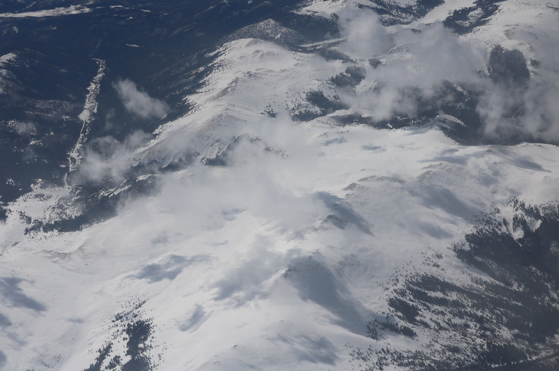 Cloud Covered, Snow Capped Mountain Range