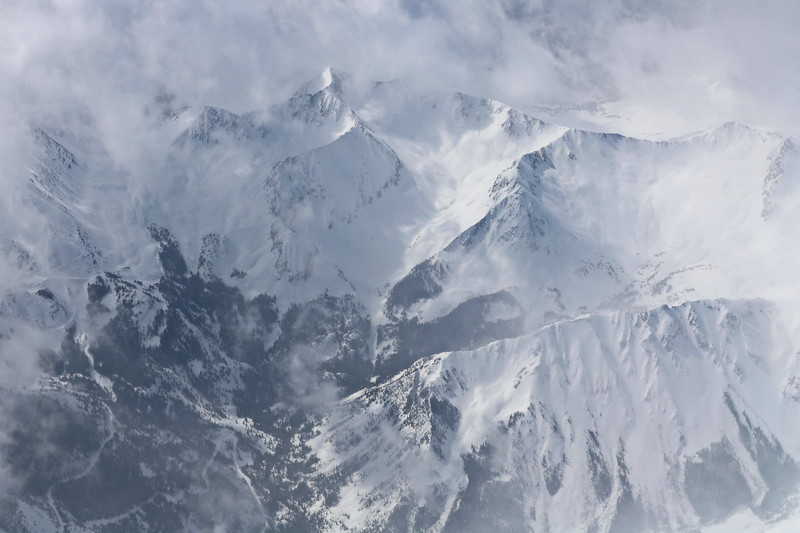 Cloud Covered, Snow Capped Mountain Pass