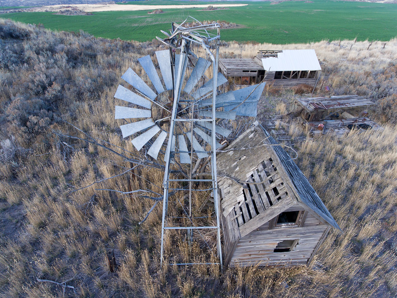 Falling windmill and several outbuildings.