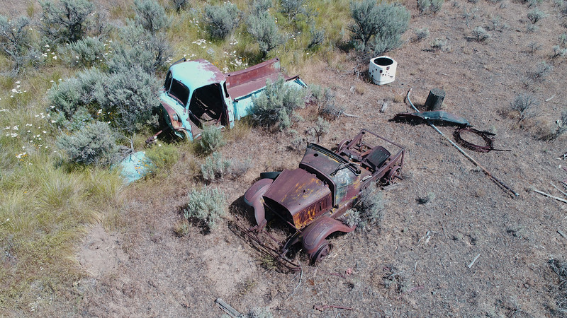 Trucks rusting in pieces.