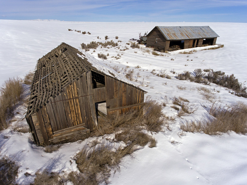 Forgotten decaying outbuildings in winter,