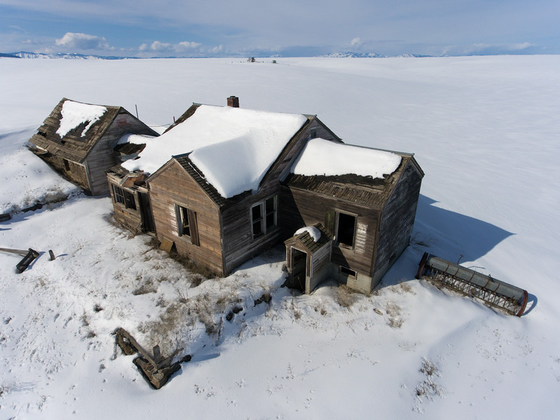 Abandoned homestead and drills.