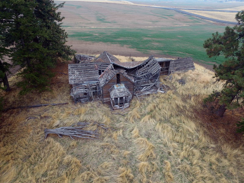 Collapsing farm house aerial view