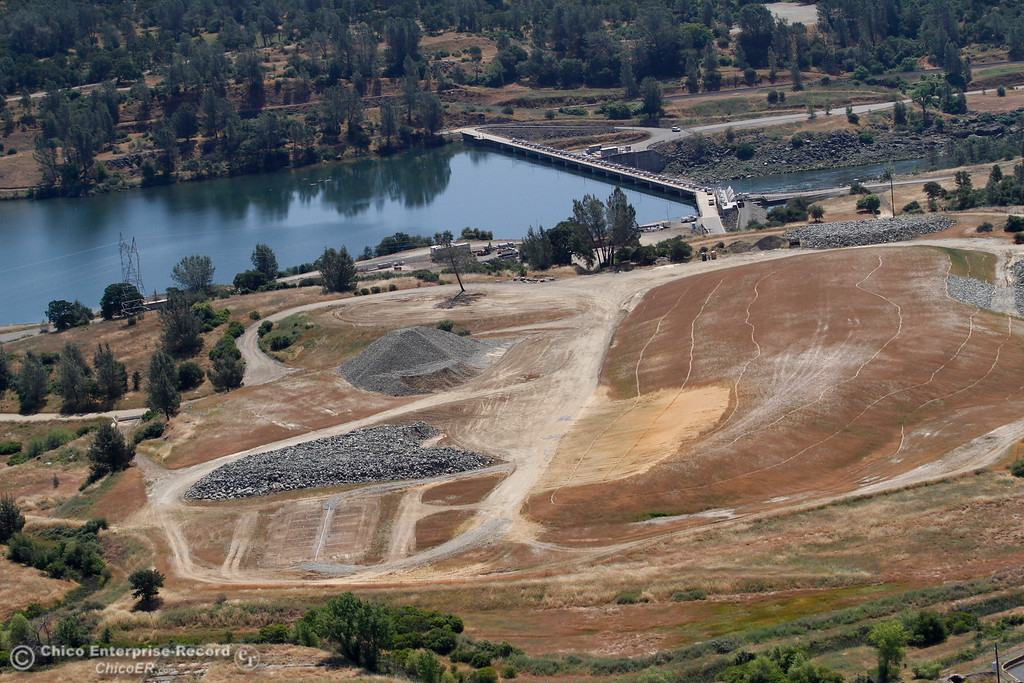 . A dump site for debris has been nearly cleaned up near the Diversion Pool dam. An aerial view of the Oroville Dam and spillway from the Butte County Sheriff\'s Office helicopter Friday, May 17, 2018, in Oroville, California. (Dan Reidel -- Enterprise-Record)