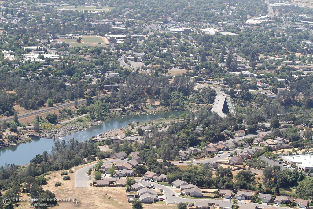 . The Feather River through Oroville. The Table Mountain Boulvard bridge is at right center of frame. An aerial view of the Oroville Dam and spillway from the Butte County Sheriff\'s Office helicopter Friday, May 17, 2018, in Oroville, California. (Dan Reidel -- Enterprise-Record)