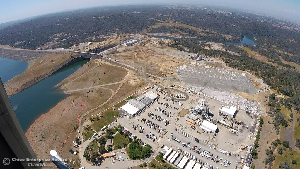 . Spillway Launch Ramp parking lot at right, dam at left. An aerial view of the Oroville Dam and spillway from the Butte County Sheriff\'s Office helicopter Friday, May 17, 2018, in Oroville, California. (Dan Reidel -- Enterprise-Record)