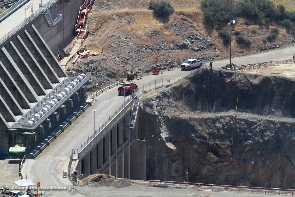 . Top of the spillway, road from dam (right) goes to Spillway Launch Ramp (bottom). An aerial view of the Oroville Dam and spillway from the Butte County Sheriff\'s Office helicopter Friday, May 17, 2018, in Oroville, California. (Dan Reidel -- Enterprise-Record)