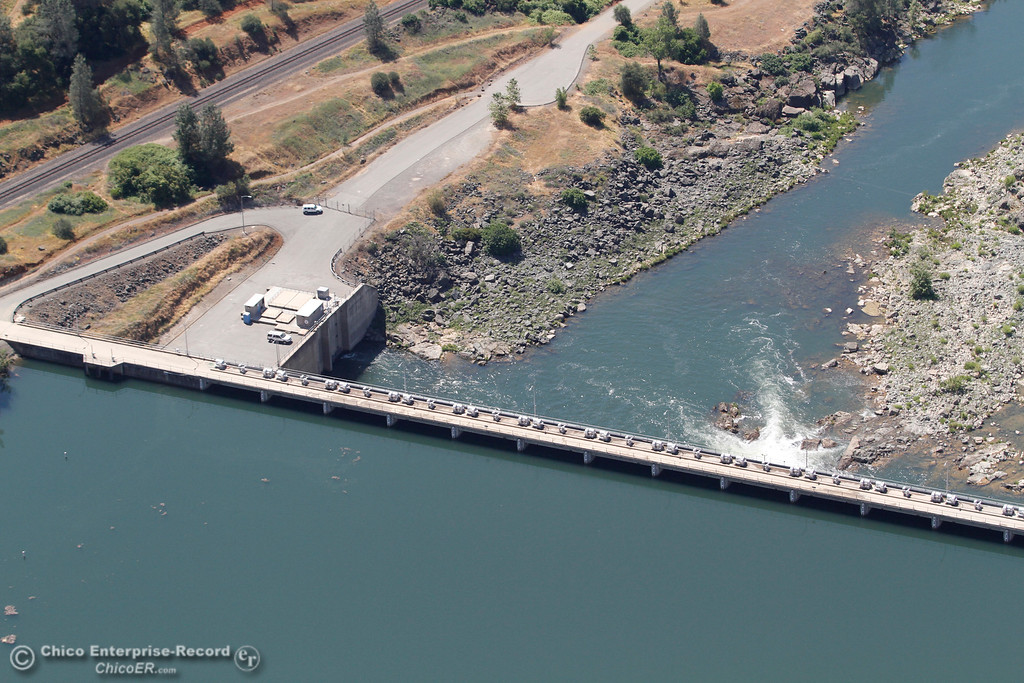 . Water flows into the Feather River from the Diversion Pool. An aerial view of the Oroville Dam and spillway from the Butte County Sheriff\'s Office helicopter Friday, May 17, 2018, in Oroville, California. (Dan Reidel -- Enterprise-Record)