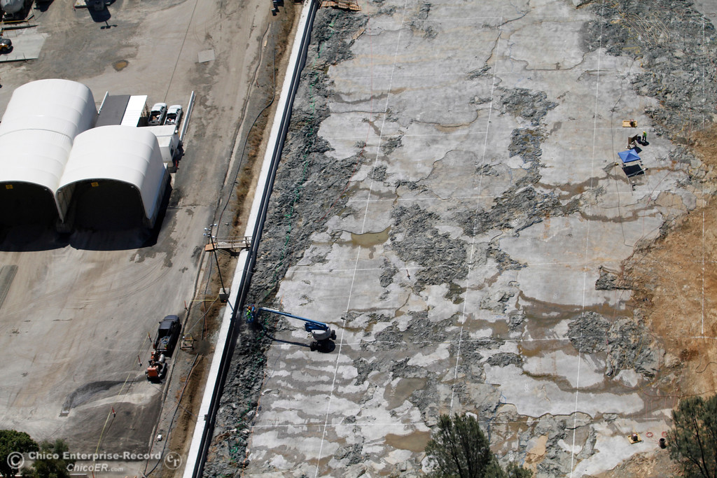 . Emergency spillway is light vertical line. To left, Spillway Launch ramp parking lot, to right, splash pad. An aerial view of the Oroville Dam and spillway from the Butte County Sheriff\'s Office helicopter Friday, May 17, 2018, in Oroville, California. (Dan Reidel -- Enterprise-Record)