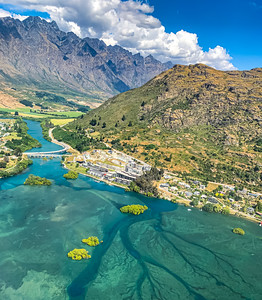 Aerial view Frankton recreational reserve near the Queenstown Airport New Zealand. River and mountain range. Southern Alp. Ka tiritiri o te Moana.