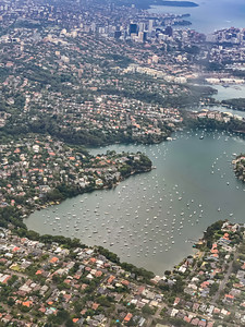 Aerial view Riverview near Sydney New South Wales Australia. Boats in the harbor create beautiful scenery. Central business district in the distance.