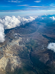 Aerial View snow capped mountain range with beautiful cloud formation  near Wye Creek New Zealand