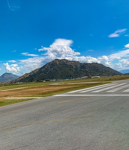Southern Alps, Ka tiritiri o te Moana surrounding Queenstown New Zealand Airport tarmac.