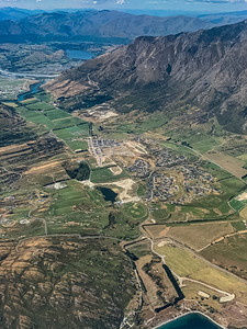 Aerial photo Jacks Point near Queenstown Airport New Zealand with the Southern Alps, Ka tiritiri o te Moana, surrounding the valley farmlands.