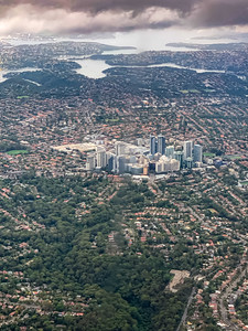 Aerial view Killara near Sydney New South Wales Australia. Central business district at the center of the image. Coastal Water in the distance.