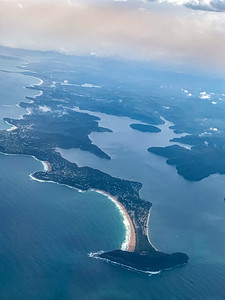 Arrow head shaped peninsula coastal Sydney New South Wales  Australia. Reddish brown hue to the sky may be due to recent bush fire in the area.