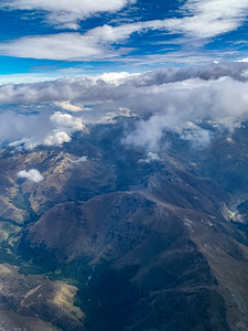 Aerial View Mountain range near Wye Creek New Zealand with beautiful cloud formation.