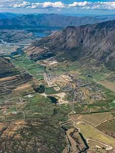 Aerial photo Jacks Point near Queenstown Airport New Zealand with the Southern Alps surrounding the valley farmlands.