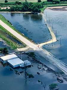 Aerial view flooded submerged roads and factory by flooded missouri river