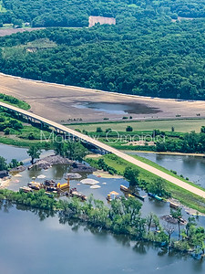 Aerial view bridge highway with flooded plains and quarry.