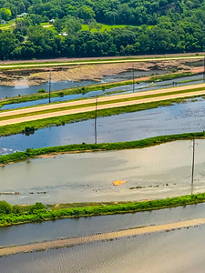 Aerial view flooded plains, farmlands and highways