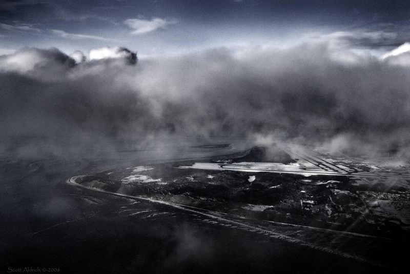 Anchorage International airport under low clouds and fog.