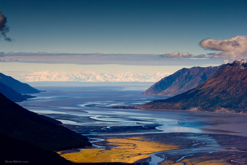 Looking West up the Turnagain Arm. Alaska range on in the distance. Anchorage is around the corner upper right.