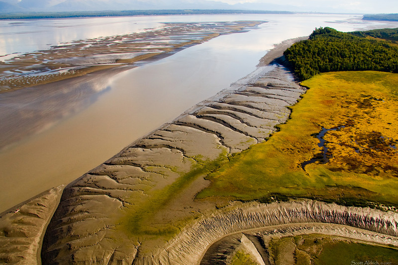 Mudflats along Knik Arm of Cook Inlet. Anchorage, Alaska is in top right corner of photo.