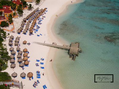 Gran Bahia Akumal Kite Aerial Photography Photos looking down towards sunbathers and beach.  © Copyright m2 Photography - Michael J. Mikkelson 2009. All Rights Reserved. Images can not be used without permission.