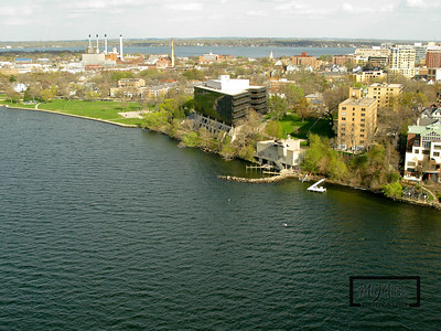 Aerial shot of Madison looking ESE from just off shore from the Lifesaving Station on Lake Mendota.  Lifesaving Station and James Madison Park overlooking the Isthmus.  © Copyright m2 Photography - Michael J. Mikkelson 2009. All Rights Reserved. Images can not be used without permission.