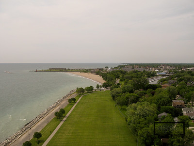 Looking south along Lake Michigan from Kennedy Park in Kenosha, Wisconsin.  The Kenosha Southport Lighthouse along with a section of downtown Kenosha can be seen in this image.  © Copyright m2 Photography - Michael J. Mikkelson 2009. All Rights Reserved. Images can not be used without permission.