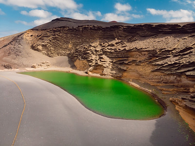 Aerial view of Volcanic crater with a green lake near El Golfo, Lanzarote.