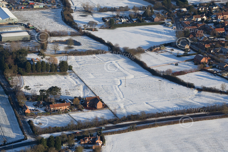 Aerial photo of Little Carlton in the snow.