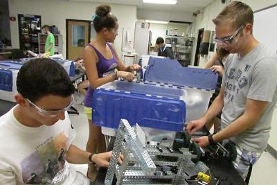 Members take apart VEX robots