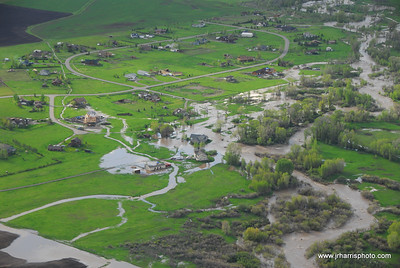 Aerial Photo of homes by east Gallatin River Bozeman area flooding 2008. Jim R Harris Photography Bozeman Montana Photographer