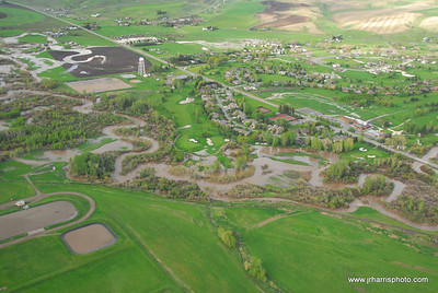 Aerial Photo of homes by east Gallatin River / Riverside Country Club  Bozeman area flooding 2008. Jim R Harris Photography Bozeman Montana Photographer