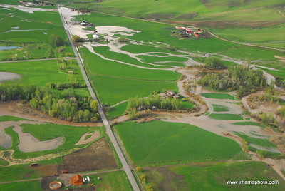 Aerial Photo of homes by east Gallatin River & McIlhattan Rd Road Bozeman area flooding 2008. Jim R Harris Photography Bozeman Montana Photographer