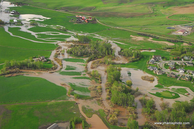 Aerial Photo of homes by east Gallatin River & Bozeman Creek at Bridger Creek Golf Course Bozeman area flooding 2008. Jim R Harris Photography Bozeman Montana Photographer
