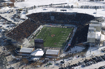 Aerial photo of Montana State University football stadium on Cat-Griz game day. The Bobcat Football Team is running out onto the field. Aerial Photography by Jim R Harris Bozeman Montana photographer.