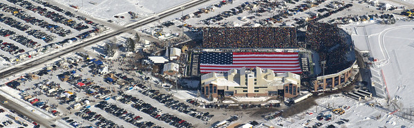 Aerial photo of the US Flag stretched over the football field prior to the start of the game. Two F-15 fighter jets flew over the stadium. Aerial Photography by Jim R Harris Bozeman Montana photographer.