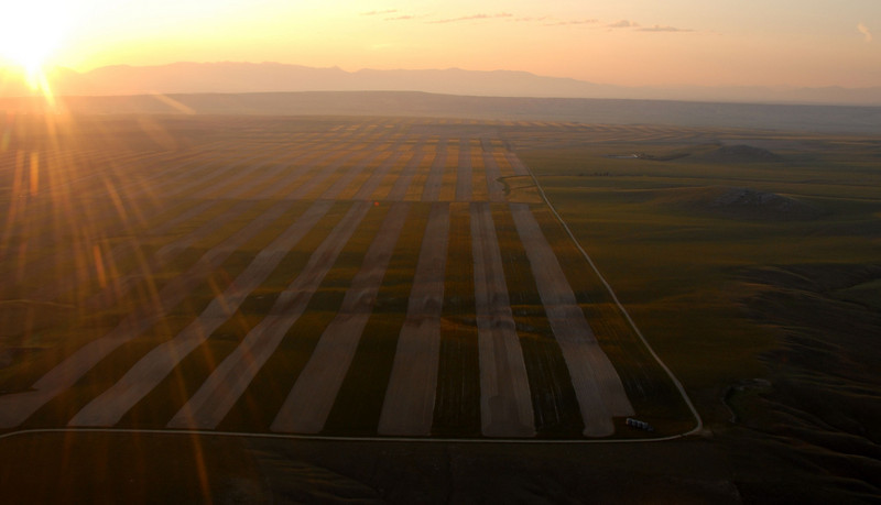 Aerial photo of sunrise over fields in Montana- Photography by Jim R Harris