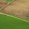 Aerial view of crop and plowed fields with John Deere tractors- Photography by Jim R Harris